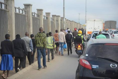 Kenyans walking in Nairobi on Monday, March 23, 2020