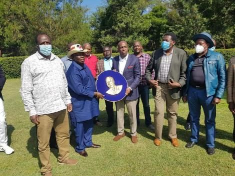 Cotu secretary general Francis Atwoli (Second from Left) hands Baringo Senator Gideon Moi a special plaque on August 1, 2020.