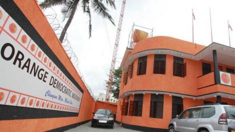 Orange Democratic Movement (ODM) logo plastered on a building.