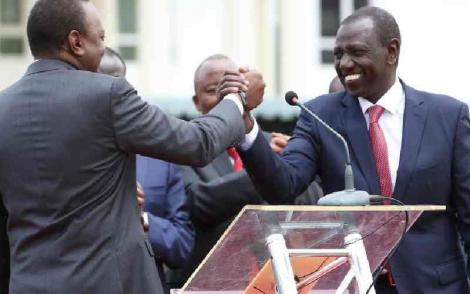 President Uhuru Kenyatta (left) and his deputy William Ruto shake hands at State House in August 2016 after forming the Jubilee Party
