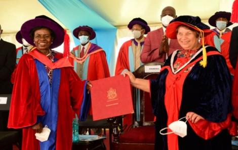 The Chancellor, Dr. Vijoo Rattansi (right) confers the Honorary Doctorate Degree, Doctor of Science (Honoris Causa) on Prof. Julia Ojiambo (left) on December 11, 2020.