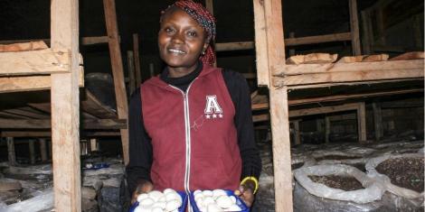 Ruth Korat, from Kabarak University, on her mushroom farm in Soy, Uasin Gishu County.