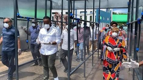 Mombasa Governor Hassan Joho flanked by Mombasa politicians Suleiman Shabhal and Mishi Mboko as they inspect a public spray booth at the Likoni Channel.