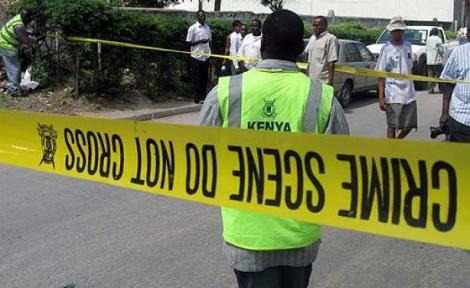 A Kenyan Police Officer at a crime scene