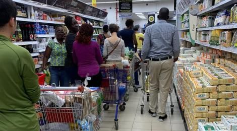 Customers queueing at a supermarket in Kenya
