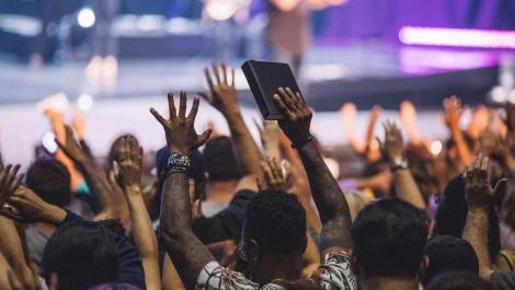 A stock photo of a church congregation worshiping