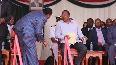 Former Kiambu Governor Ferdinand Waititu (left) speaks to President Uhuru Kenyatta.