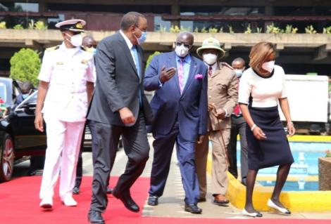 President Uhuru Kenyatta with Education CS George Magoha at KICC on Tuesday, February 9, 2021.