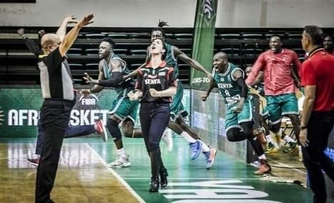 Coach Liz Mills celebrating with the Morans after they qualify for the FIBA AfroBasket 2021 tournament in Rwanda.