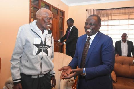 Deputy President William Ruto shares a light moment with Mzee Kibor.