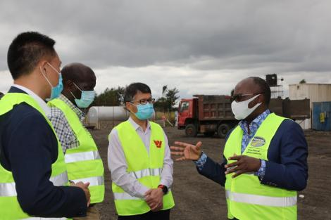 Transport Cabinet Secretary James Macharia with contractors of the Kenol-Marua dual carriageway, July 2020.