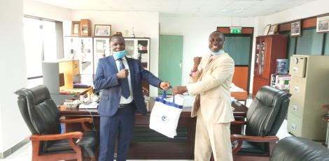 KNQA DG Dr Juma Mukhwana (left) with the National Commission for Science, Technology and Innovation (NACOSTI) DG, Prof. Walter Oyawa