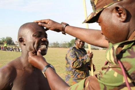 A KDF soldier conducting a recruitment exercise