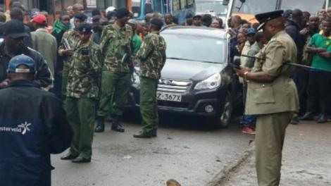 Kenya Police officers pictured at a crime scene.