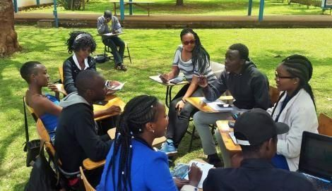 A group of college students holding a discussion.