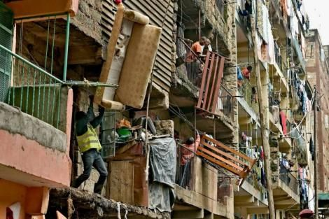 Residents move sofas and beds from a block of flats in Nairobi.