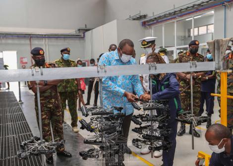 President Uhuru Kenyatta being taken through gun parts at the Ruiru Small Arms Factory on April 8, 2021