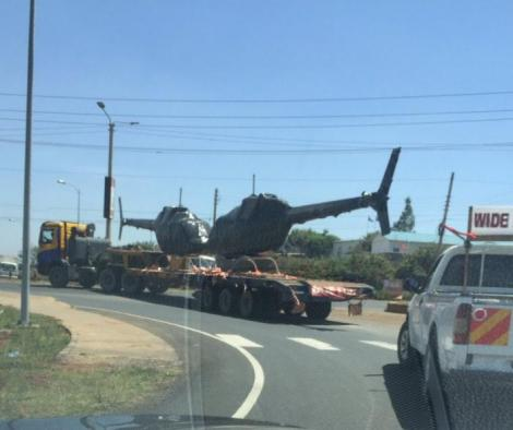 Two choppers transported behind a Haulier track along Mombasa Road in November 2018
