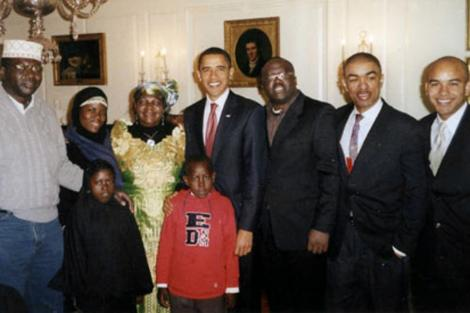 Former US President Barack Obama greets members of his British and African-based family at the White House following his inauguration, including half-brother Abongo, far left, and stepmother Kezia.
