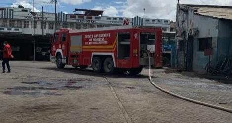 Fire fighters responding to a fire that razed down a section of Modern Coast yard next to Makupa Police Station in Mombasa on April 17, 2021.