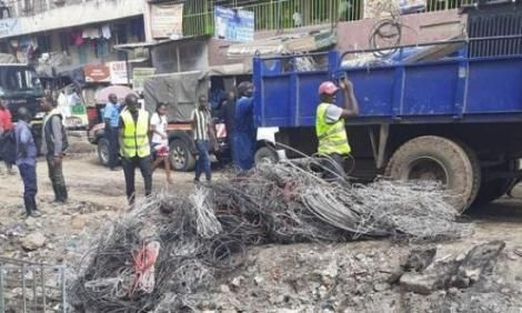 Kenya Power security personel cut off illegal power lines at Embakasi East's Tassia Estate on Thursday, February 27, 2020.