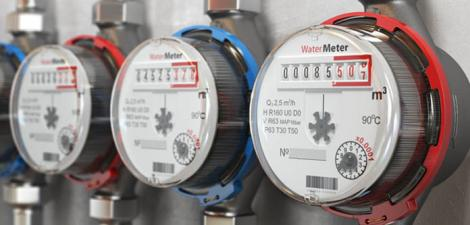 Three water meters installed on a building