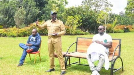 DP Ruto (standing with Kenyan artiste Khaligraph Jones (seated) during a creatives' round table on April 24, 2021.