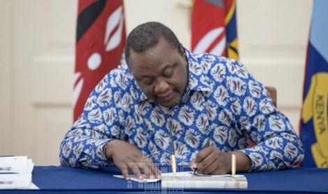 President Uhuru Kenyatta assenting to bills at State House on March 30, 2021.