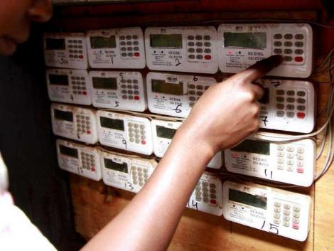 A customer keys in tokens in a prepaid electric meter
