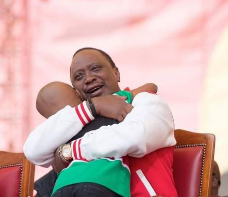 President Uhuru Kenyatta hugs Ryan Mwenda after the young entertainer performed at a Jubilee Party event in September 2016