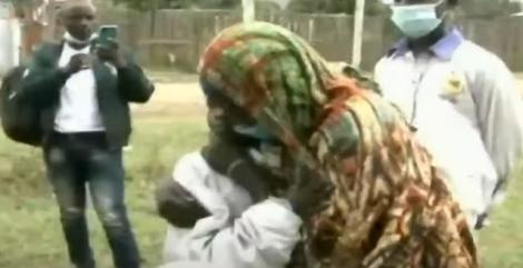 Mother and Child hug after reunion after three years.