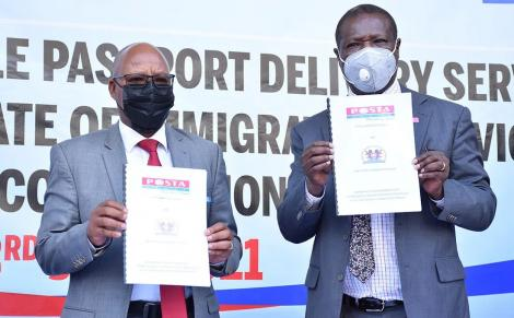 Postmaster General and CEO of Postal Corporation of Kenya, Mr. Dan Kagwe and the Director General, Directorate of Immigration Mr. Alexander Muteshi sign the passport delivery agreement on June 3. PHOTO: TWITTER