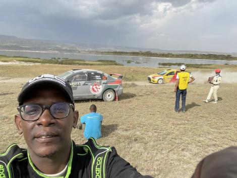 Nzioka Waita Takes a selfie next to his stalled vehicle during the World Rally Championships on June 26
