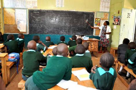 A teacher and students inside a classroom at Kawangware Primary School, Nairobi, on October 5, 2015.