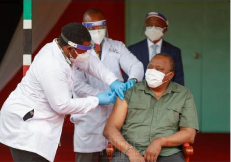 President Uhuru Kenyatta takes the Covid-19 Vaccine at State House, Nairobi on March 26, 2021.