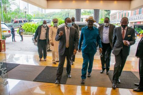 ODM party leader Raila Odinga flanked by Suna East MP Junet Mohamed on Thursday, July 1.