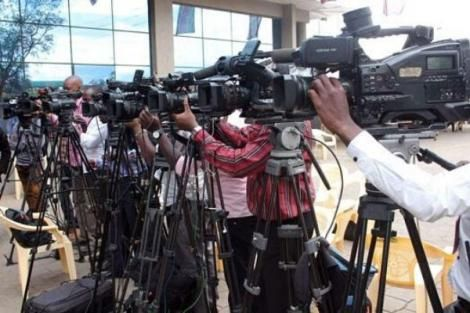 Journalists docked at a media center while covering an event.