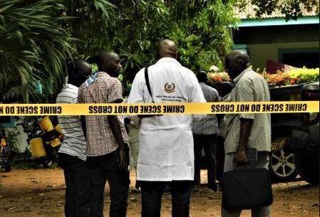 DCI detectives probe a crime scene in Kenya.