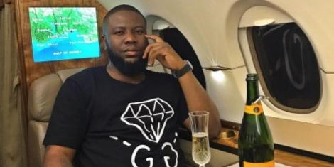 Hushpuppi poses for a photo in a private jet