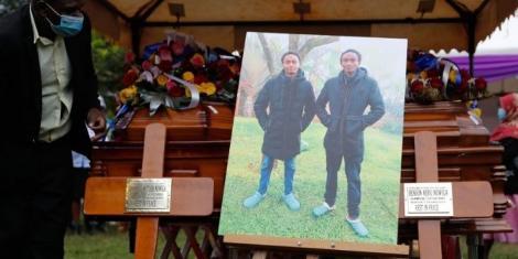 The caskets of the Kianjokoma brothers, Benson Njiru, 23, and Emmanuel Mutura, 19, who are being buried at their father's farm in Kithangari Kianjokoma in Embu North.