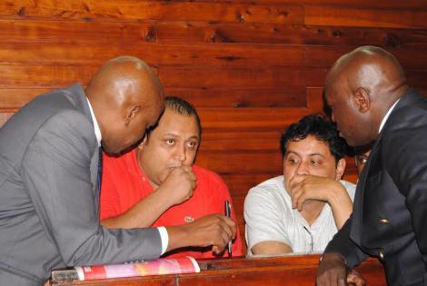 Baktash Akasha and Ibrahim Akasha with lawyers Gikandi Nguibuini (Left) and Cliff Ombeta at Mombasa Law courts on November 11, 2014.