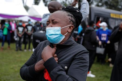 Catherine Wawira, the mother of the slain brothers, overwhelmed by emotions during the burial on Friday, August 13.