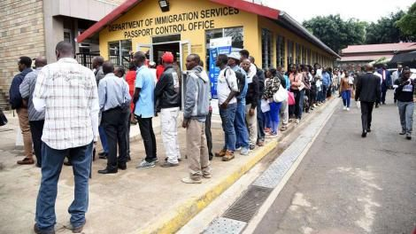 People queue for passports outside the Nyayo House headquarters in Nairobi.