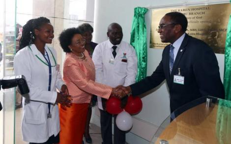Karen Hospital chairman Dr James Mageria (right) with the hospital's CEO Dr Betty Gikonyo and staff members