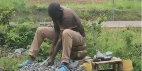 An undated file image of Samuel Ouma crushing stones in Kakamega County.