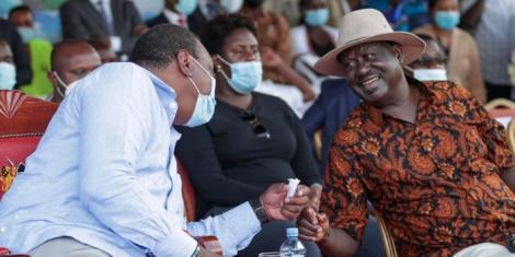 President Uhuru Kenyatta shares a light moment with ODM leader Raila Odinga at the Jaramogi Oginga Odinga Stadium