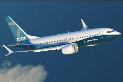 A Boeing 737 plane while flying in the sky