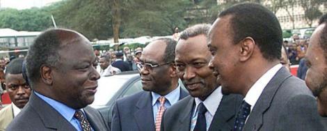 Former President Mwai Kibaki (left) with President Uhuru Kenyatta (right) in an event in 2010
