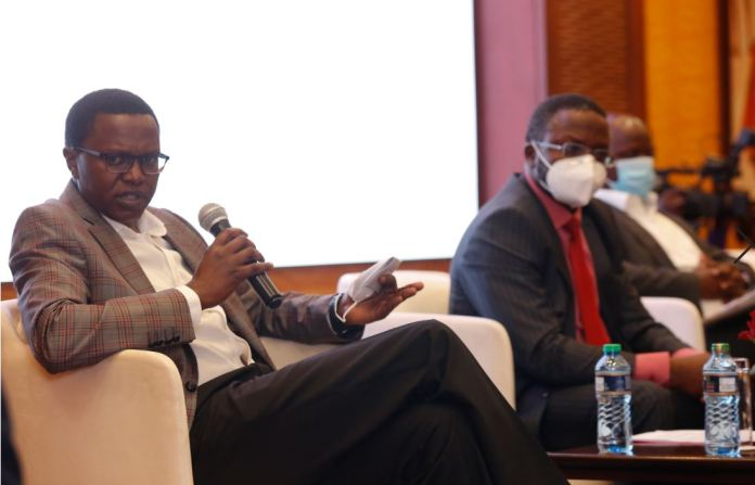 Coca-Cola Beverages Africa – Kenya Sales and Marketing Director, Josephat Mwangi (left) addressing the media fraternity during the Launch of Coca-Cola System Small Business Recovery support at Serena hotel.