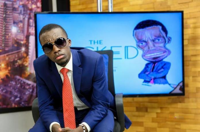 Dr King'ori Strikes a pose on the set of his Wicked Edition show.